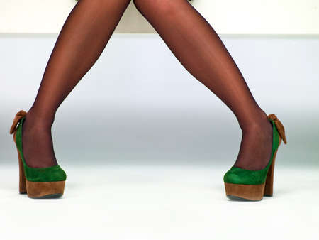 picture of female legs in shoes on a white background Stock Photo - 17668558