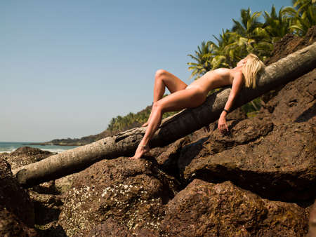 Photo nude girl on the beach in Goa India photo
