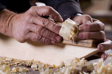 wood planer: Photo of male hands are made of wood planer Stock Photo