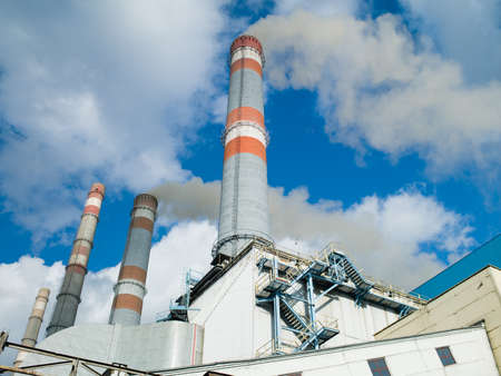 Photo thermal power plant smoking chimneys against the sky and clouds Stock Photo