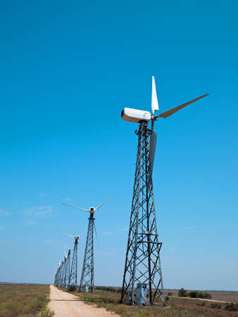 generates: Photo in the nature of a large wind turbine generates electricity Stock Photo