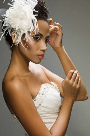 African-American bride in a dress on a white background photo