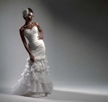 African-American bride in a dress on a white background