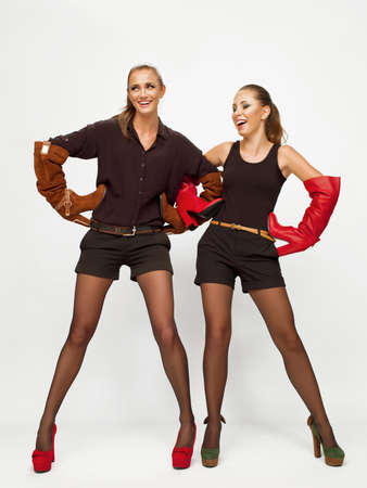 Photo of two girls in the studio shooting Stock Photo - 20838038