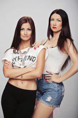 photograph of two beautiful girls on the set of models in studio photo