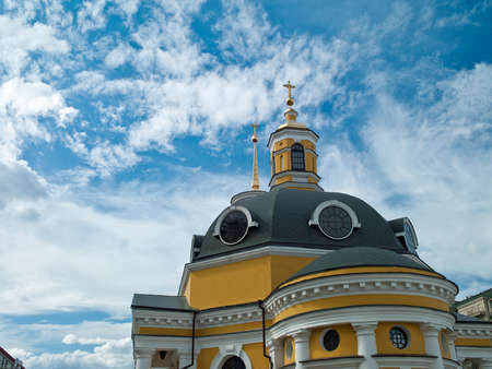 Photo Orthodox Church with dark domes on a background of sky and clouds