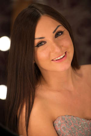 Photo portraits of beautiful girl in the studio shooting