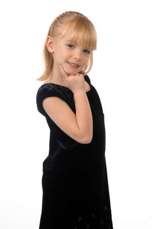 Photo of a little girl in a black dress posing on camera