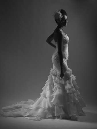 Photo of a beautiful girl in a wedding dress African American photo