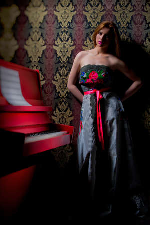 Photo of a beautiful teen girl filming in studio near the piano variety of images