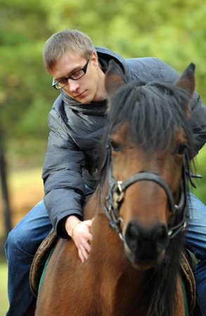 boy rides a horse riding