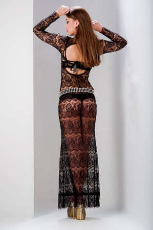 Photo of beautiful cute woman wearing a long dress in the studio