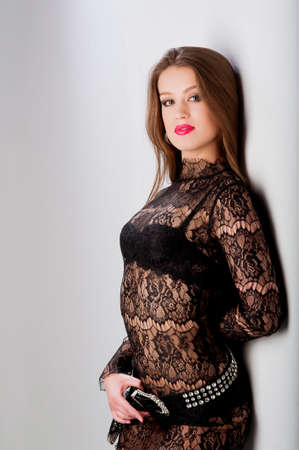 beautiful young woman in a fashionable black dress Stock Photo
