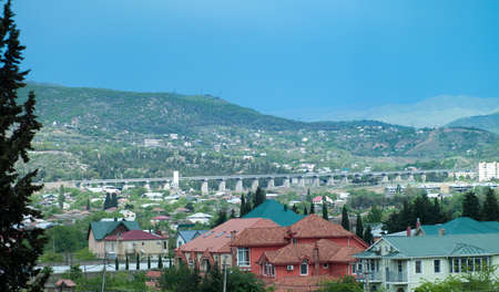 Beautiful scenery of Tbilisi against mountains photo