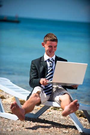 Businessman at the beach with noutbukom Sevastopo,l Crimea photo