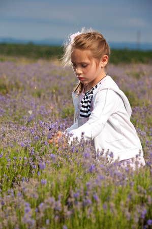 Little girl on a lavender field