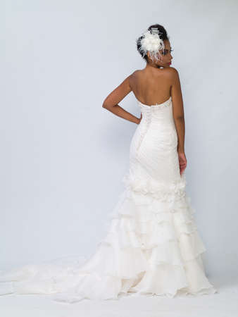 wedding dress: African-American bride in a dress on a white background