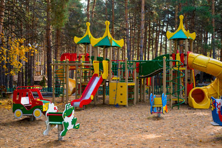 A childrens playground in the woods Stock Photo