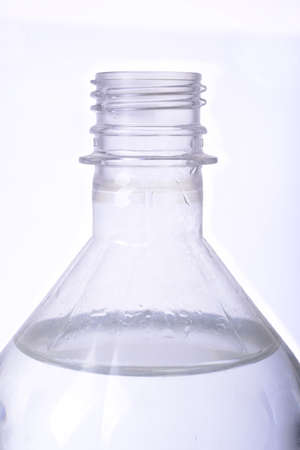 The neck of a plastic bottle on a white background