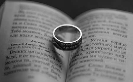 The religious book and a ring with the inscription Donetsk Stock Photo