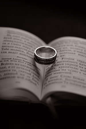 donetsk: The religious book and a ring with the inscription Donetsk Stock Photo