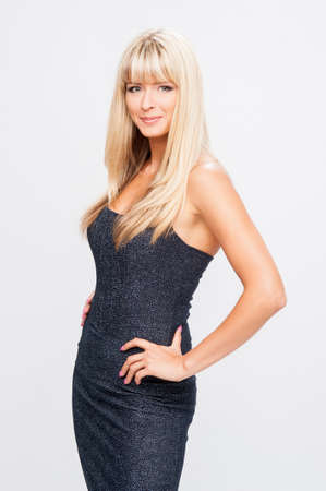 beautiful girl in a black dress on a white background Stock Photo
