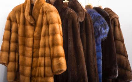 Fur coats on hangers in the interior
