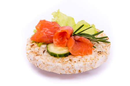 Sandwich with red fish and vegetables on rice bread