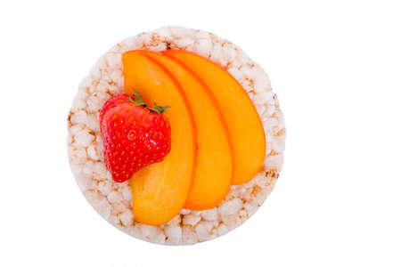 Sandwich with peach and strawberries on a rice bread