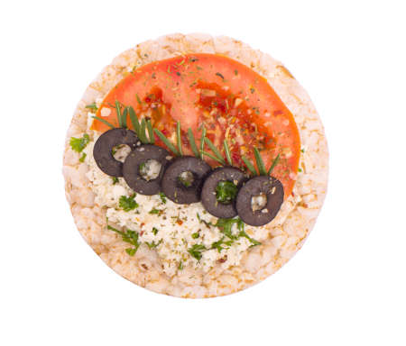 Sandwich with cheese, tomato and olives on bread