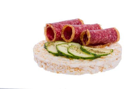 Sandwich with sausage and cucumber on rice bread