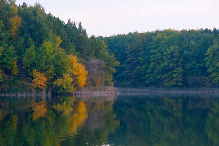 View of the lake in the evening autumn. Stock Photo