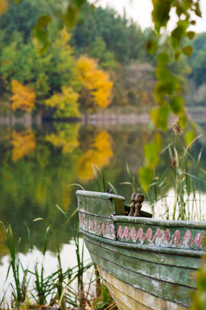 Boat on the lake in the fall. Stock Photo