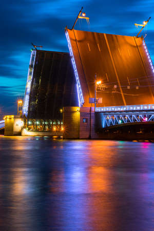 Swing bridge at night in Saint-Petersburg