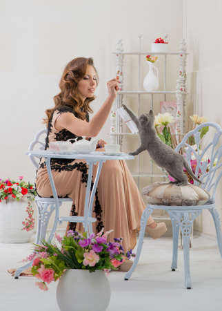 woman in a dress and a cat