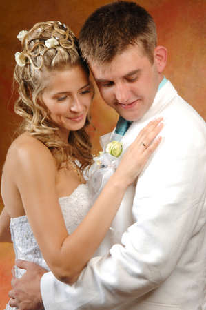 Photo of bride and groom on their wedding day filming an expression of joy Stock Photo