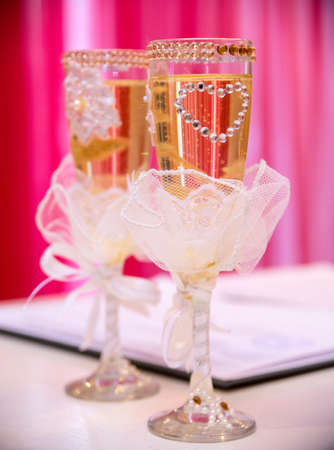 Beautifully decorated wedding glasses on the table. Stock Photo