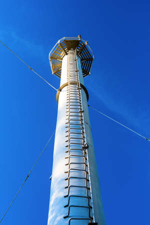 Tower with a ladder against the blue sky. Stock Photo