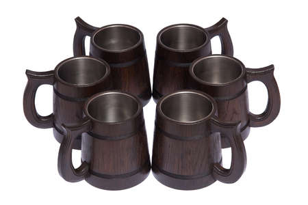 Beer mugs made of wood on a neutral white background.