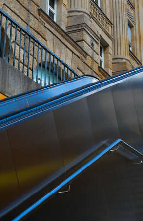 Escalator for lifting against the background of the building on the street.