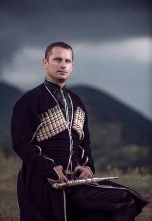 A man in nature in national clothes of Georgia.