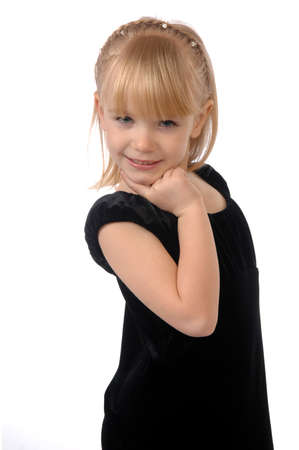 Little girl in a black dress on a neutral white background.
