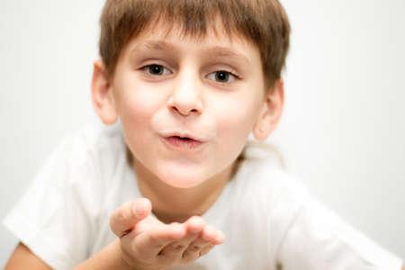 boy in a white sending a kiss Stock Photo - 8405661