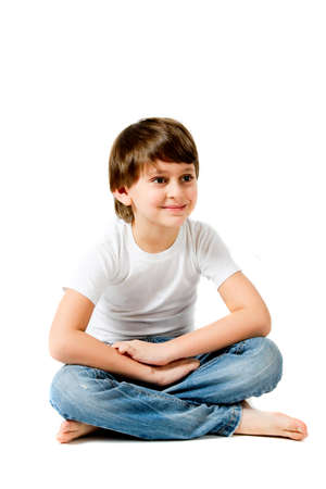 boy sitting on the floor and smiling photo