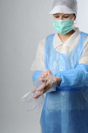 worker wearing plastic gloves photo