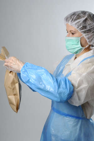 worker packing brown bag Stock Photo - 6053352
