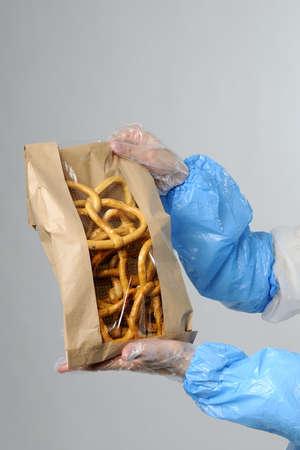 pretzel in brown bag photo
