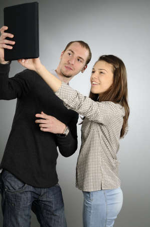 young woman showing to her colleague Stock Photo - 8303235