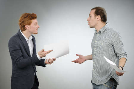 conflict: chief explaining contracts Stock Photo