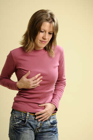 woman having abdomen cramps Stock Photo - 8366515